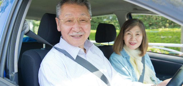 Elderly people riding in a car