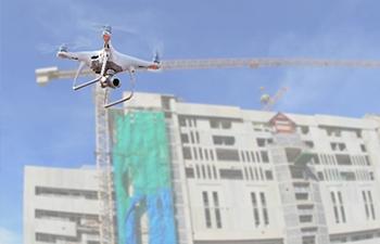 鹿島建設が行うドローンの自動制御による現場管理のイメージ