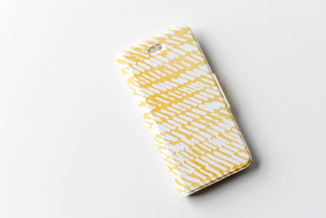 【次回入荷未定】iPhoneケース/夕日にゆれる波/KURASHI&Trips PUBLISHINGの商品写真