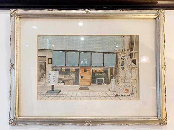 お店の壁には初代・国分町店の絵が飾られている