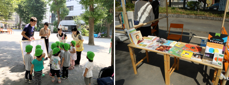 投票ボードに集まる公園を散歩中の保育園児たち/公園を楽しむコンテンツとして図書館の本を提供