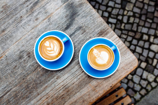 Two blue cups of coffee on ...