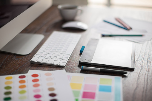 Closeup of a graphic designer's desk