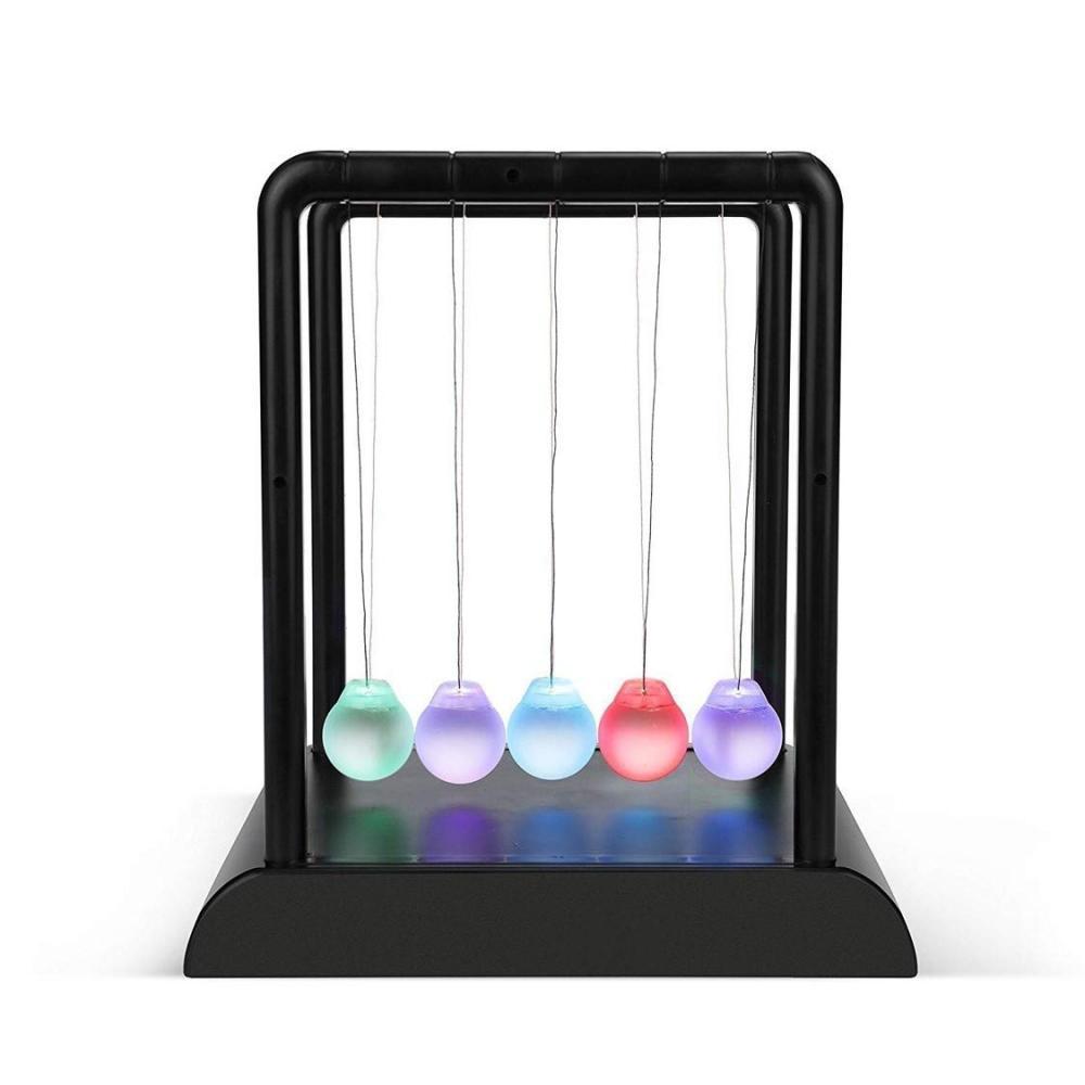 LED shines Newton's cradle Newton cradle emitting light colorful ticking ball pendulum collision spheres