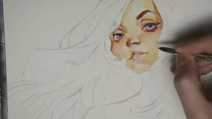 水着の女性の顔を描く