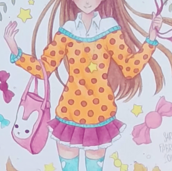 服の色に合わせた色鉛筆で描きこむ