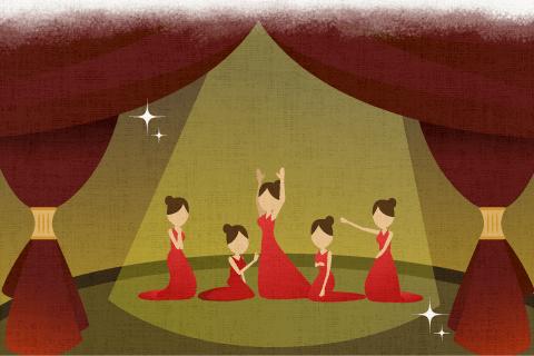 舞台の上に五人の女性がいる。の英作文