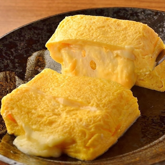 """Simmering cheese out-turn"" of Takeniwatori eggs"