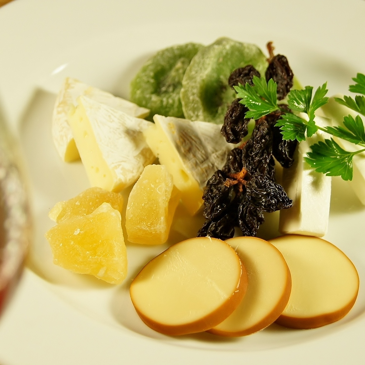 Three kinds of cheese and dried fruit