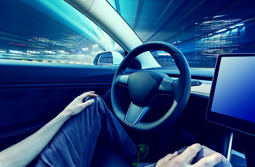 Person using car in autopilot mode hands free