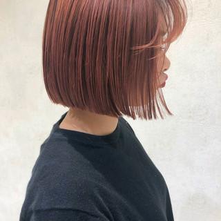 アプリコットオレンジ ミニボブ 切りっぱなしボブ オレンジカラー ヘアスタイルや髪型の写真・画像