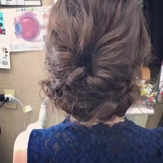 シニヨン セミロング ロープ編み ナチュラル ヘアスタイルや髪型の写真・画像