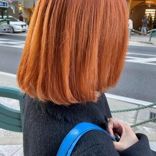 オレンジ ブリーチカラー ミディアム オレンジカラー ヘアスタイルや髪型の写真・画像