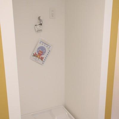キッチンの後ろには洗濯機置場※写真は前回募集時のものです