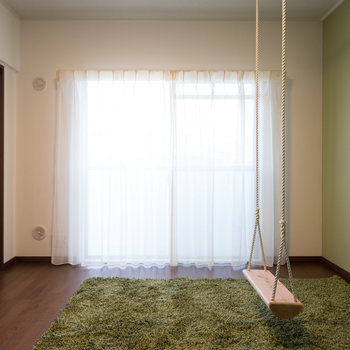 グリーンの落ち着いた雰囲気です。※写真は1階の同間取り別部屋のものです。