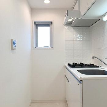玄関前の空間にキッチンがあります!※写真は4階の同間取り別部屋のものです