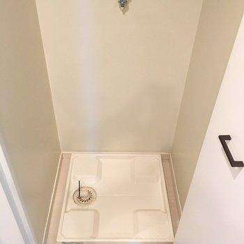 洗濯置き場は隠し扉つき※写真は6階の同間取り別部屋のものです。
