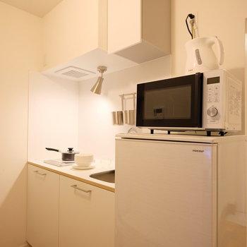 居室と一線離れた箇所にキッチン、水回りスペースをまとめて