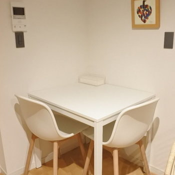 Dining table with two chairs.