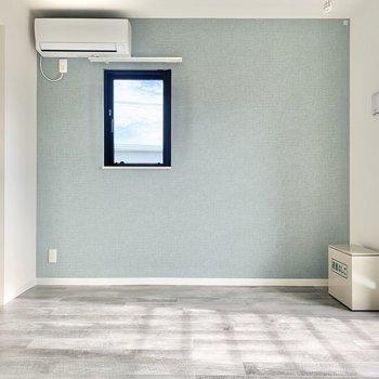 ミントグリーンのクロスがさわやか※写真は3階の同間取り別部屋のものです