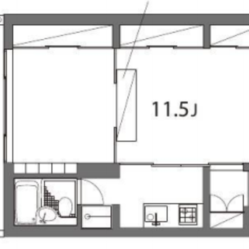 パーテーションで1Rをやんわりと分けた空間になっています。