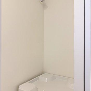 洗濯機置き場は洗面台の目の前に。※写真は前回募集時のものです