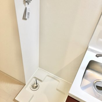 洗濯機置き場はキッチン横に。