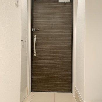 玄関は台形になっています。※写真は9階の同間取り別部屋のものです