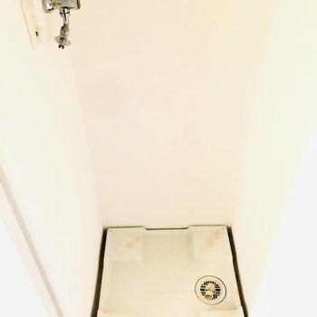 洗濯機置き場は扉付き(※写真は4階の同間取り別部屋のものです)