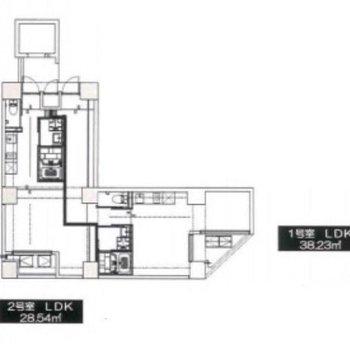 お部屋は1号室のL字の間取りです