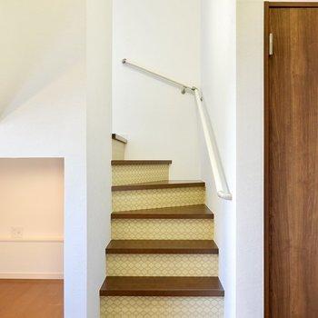 階段を登って上へ。ここにも緑のクロスが使われています。