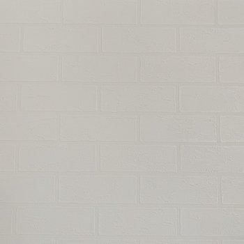 デコボコレンガ調のおしゃれな壁紙になっていました!(※写真は7階の同間取り別部屋のものです)