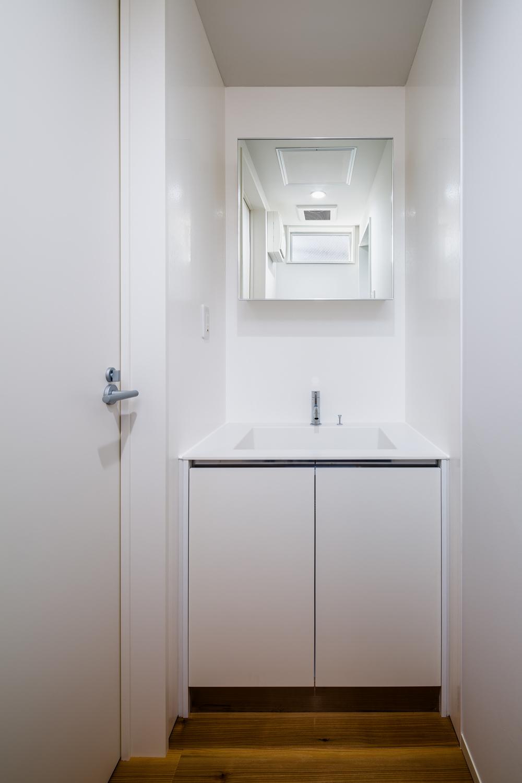 シンプルな洗面所 リノベーションアパートメント リフォーム