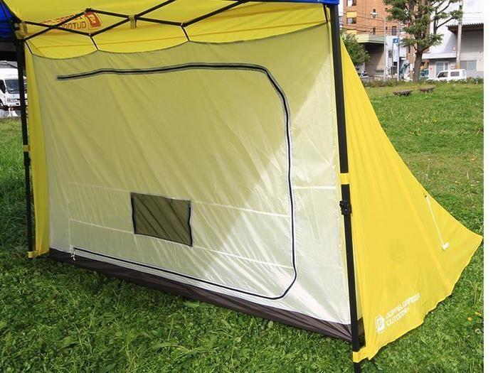 タープをつけたテント