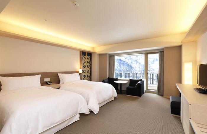 キロロリゾートのホテル、トリビュートポートフォリオホテル 北海道のベッドルーム
