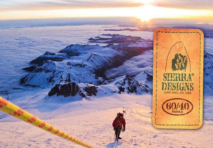 シェラデザインのロゴと雪山を登る男性