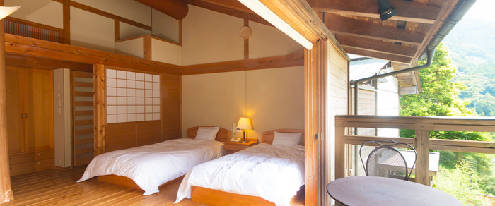 中津渓谷ゆの森のコテージ内のベッド