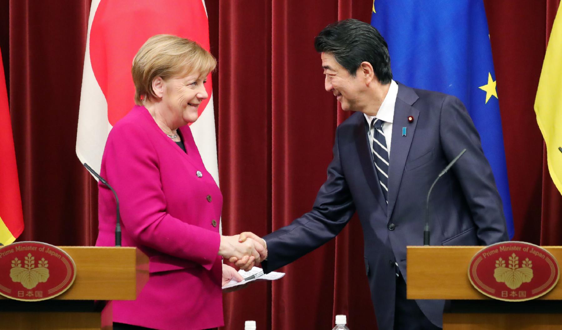 Merkel courts Abe as Berlin rethinks China-centric stance - Nikkei Asia