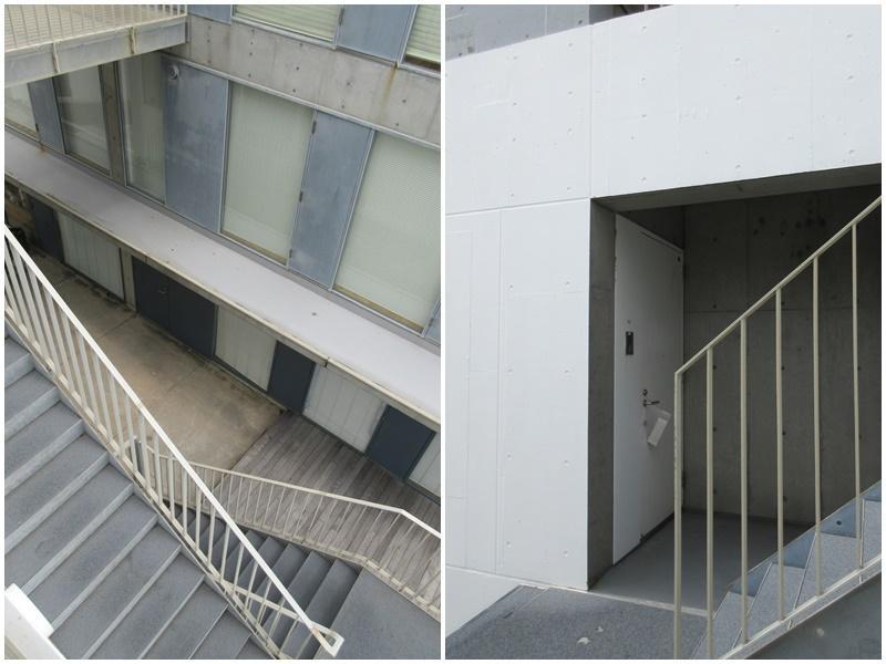 住民しか入れない住居部分への階段|玄関ドアまわり