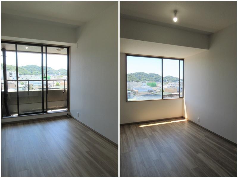 洋室2部屋。それぞれ窓の先には山の緑