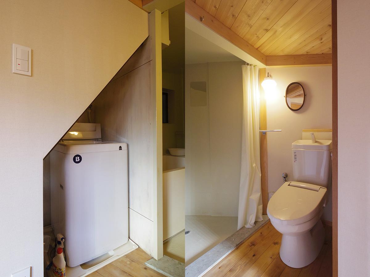 階段下に洗濯機置き場、トイレと風呂はカーテンで仕切るつくり