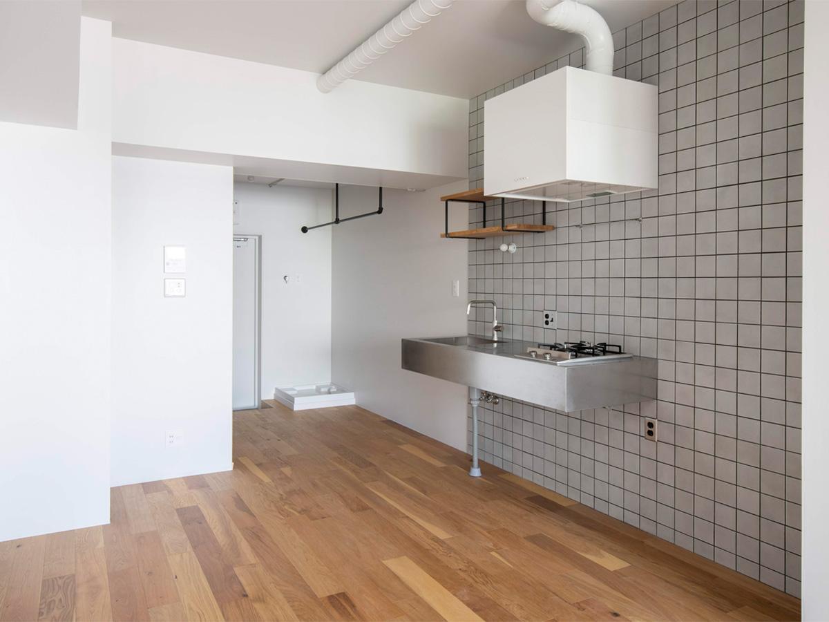 洗濯機置き場の上部にハンガーパイプを設置(10階)