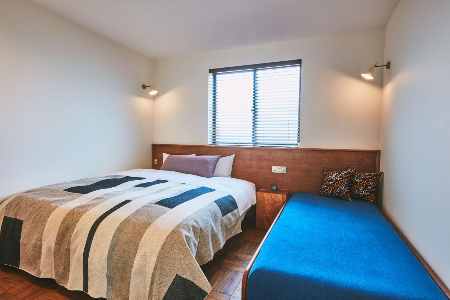 THE FLOW KAMAKURA (ザ フロウ カマクラ)KIRAベッドルーム/キングサイズベッド