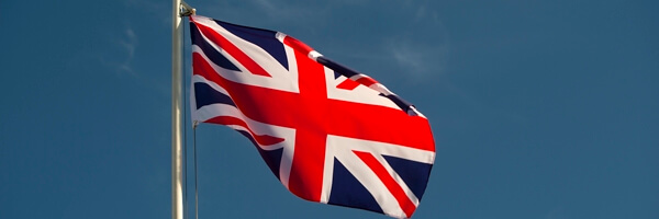 Great Britian flag in front of a blue sky