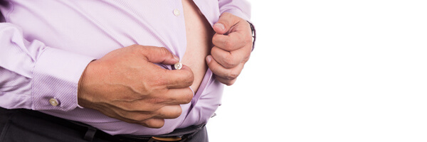 Man with unhealthy big belly unbutton tight shirt to relief