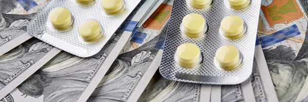 Yellow pills lie on american dollars banknote.