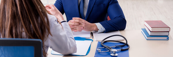 Man signing medical insurance contract
