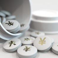 Close-up shot of pills with stamped yen symbol on them. Expensive drugs or financial remedy conceptual 3D rendering