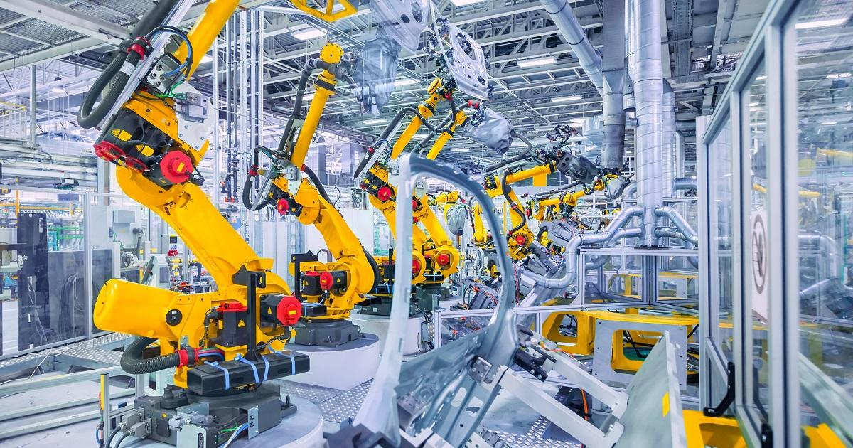 robotic arms in a car plant