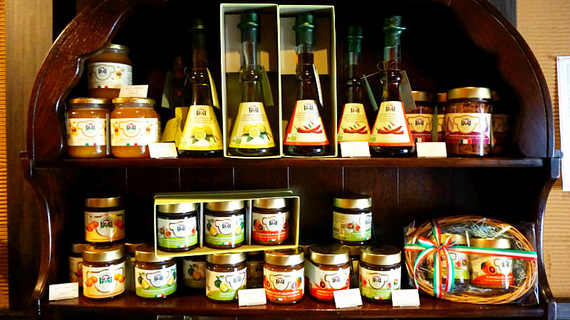 Different kinds of jams, olive oils, pickles and dried tomatoes